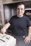 Restaurant owner working cash register.  Stock Images