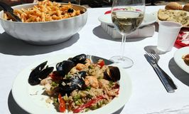Restaurant with pasta and paella rice with mussels Royalty Free Stock Images