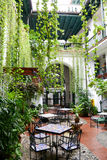 Restaurant on a patio of a colonial house Royalty Free Stock Photography