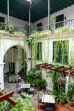 Restaurant on a patio of a colonial house Royalty Free Stock Images