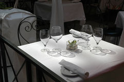 Restaurant Patio Dining with Wine. Restaurant fine dining outdoor patio table in the sunlight with wine glasses stock image