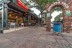 Restaurant and people and Smokers Arch in Umhlanga Rocks Village Royalty Free Stock Photo