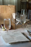 Restaurant place setting. Menu, water and wine glasses at place setting in a restaurant Royalty Free Stock Photo
