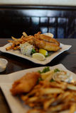 Restaurant plated dish, fish and chips meal stock photography