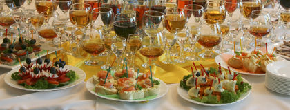 Restaurant. Plates with sandwiches and glasses of wine on a table at restaurant Royalty Free Stock Images