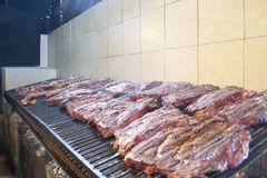 A lot of meat on a big grill royalty free stock photography