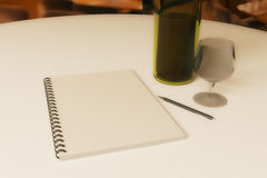 Restaurant rating and criticism concept. Close up of dining table with blank spiral notepad, wine, cutlery and pen. Restaurant rating and criticism concept. 3D stock illustration