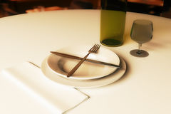 Restaurant rating and criticism concept. Close up of dining table with wine, napkin, crossed fork and knife on plate. Restaurant rating and criticism concept. 3D royalty free illustration