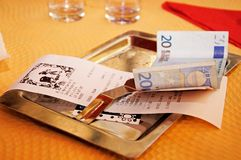 Restaurant receipt and money. Royalty Free Stock Photography