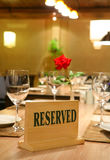 Restaurant reservations. A reserved table in the restaurant for a business meeting Royalty Free Stock Photography