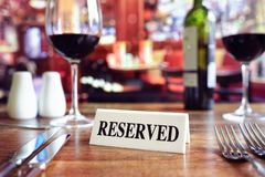 Reserved sign on restaurant table with bar background royalty free stock photos