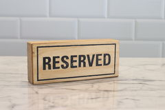 Restaurant reserved table sign on table Stock Image