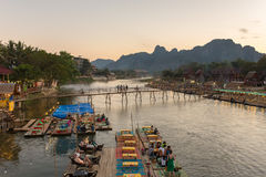 Restaurant on the riverfront during sunset in Vang Vieng, Laos Royalty Free Stock Image