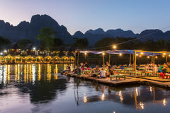 Restaurant on the riverfront during sunset in Vang Vieng Royalty Free Stock Photography