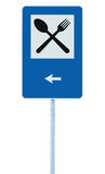 Restaurant road sign on post pole, traffic signage, blue isolated dinner bar catering fork spoon signage, left side pointing arrow Royalty Free Stock Photo
