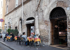 Restaurant in Rome. Typical restaurant in the street Via del Portico d`Ottavia. Ghetto of Rome Royalty Free Stock Photo