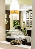 Restaurant room set up for fine dining festive meal. Fine dining restaurant room set up for festive holiday season christmas meal with pressed white linen royalty free stock photography