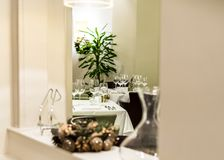 Restaurant room set up for fine dining festive meal. Fine dining restaurant room set up for festive holiday season christmas meal with pressed white linen royalty free stock image