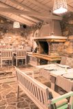 Restaurant. Rustic Restaurant interior with stone walls and pizza oven. Skiathos. Greece 2018 stock photography