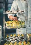 Restaurant's chef preparing buffet sweet dessert dinner royalty free stock photos