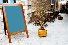 Restaurant's terrace with blackboard Royalty Free Stock Photo