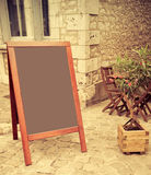 Restaurant's terrace with blackboard Stock Photos