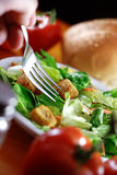 Restaurant Salad On Wooden Table. Royalty Free Stock Photography