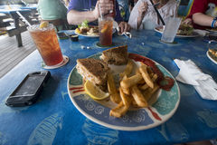 Restaurant sandwich and fries. Ice tea, lunch with grouper sandwich, lemon and fries Royalty Free Stock Image