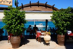Restaurant by the sea, Elounda. Stock Photo