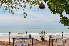 Restaurant by the sea in the open air in the shade. Of a tree Stock Photos
