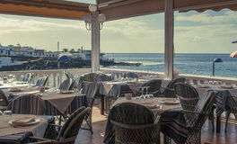 Restaurant sea view terrace. Tropical restaurant sea view terrace with nobody Royalty Free Stock Images