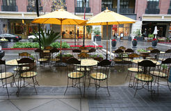Restaurant Seating. Chairs and tables of a restaurant seating outside with a shopping center background royalty free stock image