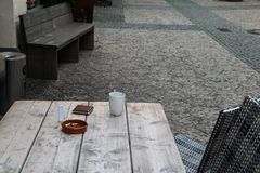 Restaurant seats outside on a cobblestoned side walk stock photography