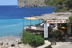 Restaurant with sea view at the isle of Mallorca, Spain. Restaurant along the sea at Cala Sa Calobra, Mallorca (Majorca), Spain Stock Photography