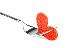 Restaurant series, decorative red heart near one fork, concept of couple's dinner Royalty Free Stock Photos