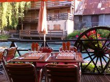 Restaurant Serre Chevalier. Outdoor seating by the Stock Photography