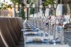 Restaurant serving and glass wine and water glasses, forks and k stock photo