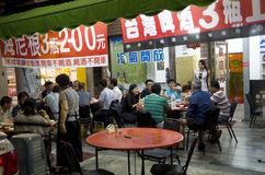A restaurant serving people on the street Royalty Free Stock Images