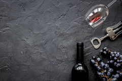 Restaurant set with wine bottle and grape on stone top view mock-up. Restaurant set with red wine bottle and grape on dark stone background top view mock-up Stock Images
