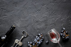 Restaurant set with wine bottle and grape on stone top view mock-up Royalty Free Stock Images