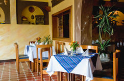 Restaurant setting in Antigua. Restaurant setting with tables, tablecloths, and chairs in Antigua Guatemala Royalty Free Stock Photos