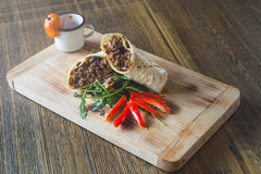 Restaurant shawarma with beams. On a wood table Royalty Free Stock Image