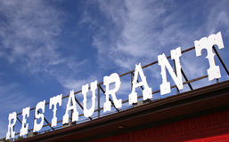 Restaurant Sign. Vintage Restaurant Sign With Blue Sky Royalty Free Stock Images