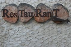 Restaurant sign. Rustic old looking restaurant sign in wood Royalty Free Stock Image