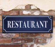 Restaurant Sign on Brick Wall royalty free stock photos