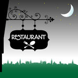 Restaurant sign. Colorful illustration with a plate with the word restaurant hanging from a building`s wall Royalty Free Stock Photo