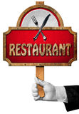 Restaurant - Sign with Hand of Waiter Royalty Free Stock Photography