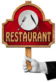 Restaurant - Sign with Hand of Waiter Royalty Free Stock Images
