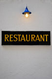 Restaurant Sign with Lamp Stock Photography
