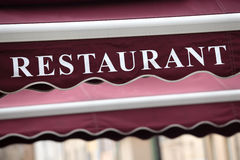 French restaurant canopy sidewalk cafe sign Paris France Royalty Free Stock Images